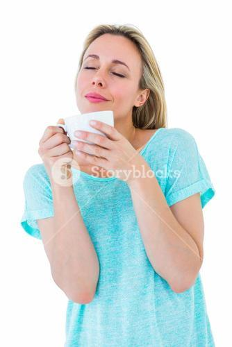 Peaceful blonde with hot beverage relaxing