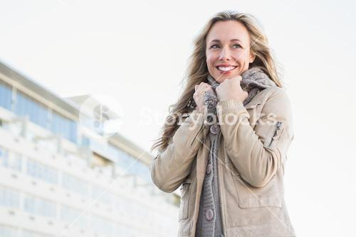 Portrait of smiling blonde in warm clothes