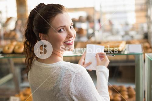 Woman checking her shopping list