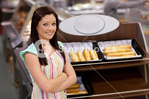 Selfassured female cook smiling at the camera