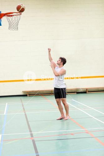 Goodlooking man playing basketball