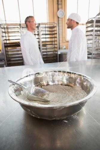 Close up of mixing bowls and scoops on flour