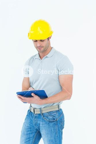 Architect writing notes on clip board
