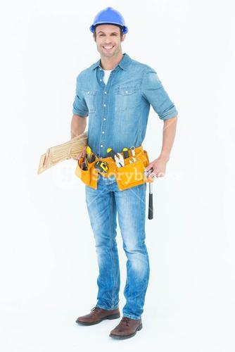 Happy carpenter with wooden planks