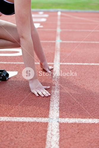 Close up of a woman waiting in starting block