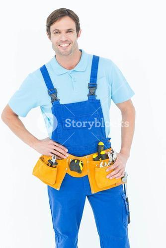 Confident carpenter with hands on hip