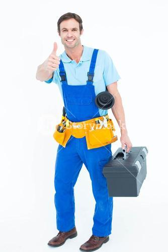 Plumber carrying tool box while gesturing thumbs up