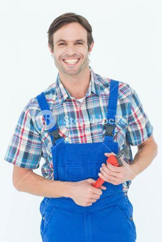 Confident plumber holding monkey wrench