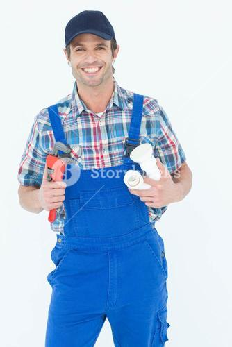 Plumber holding monkey wrench and sink pipe