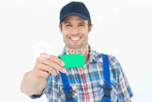 Happy plumber showing green card