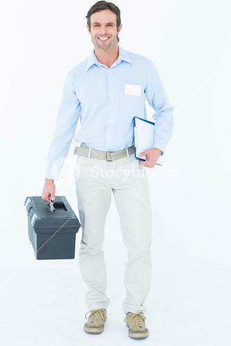 Happy supervisor carrying tool box and clipboard