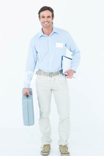 Confident supervisor carrying tool box and clipboard