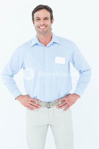 Confident businessman with hands on hip