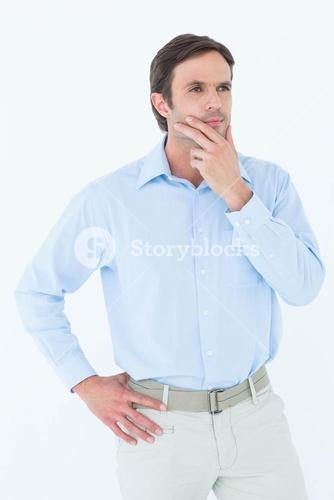 Businessman with hand on chin looking away