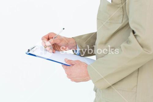Delivery man writing on clipboard