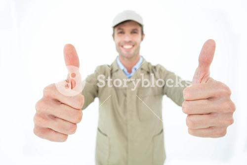 Smiling delivery man showing thumbs up