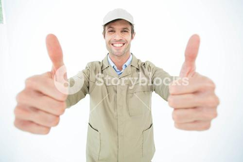 Happy delivery man showing thumbs up