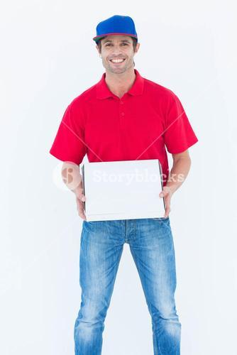 Happy delivery man holding pizza box