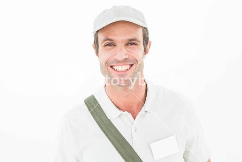 Smiling delivery man wearing cap