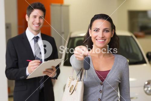 Happy customer holding a car key