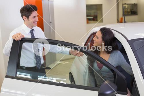 Salesperson speaking with happy client