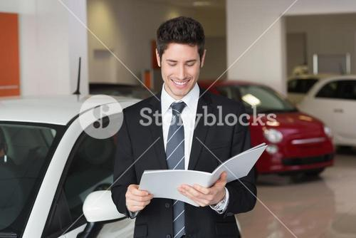Businessman reading over a booklet