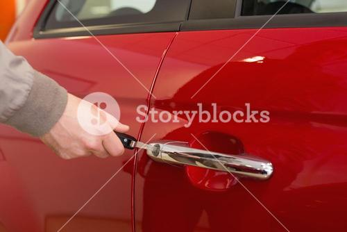 Man opening a car with a key