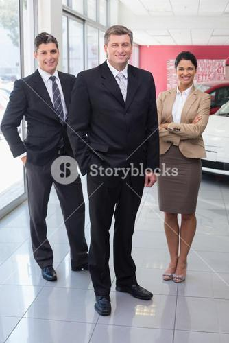 Smiling business team standing together