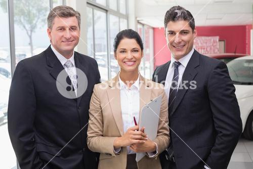 Smiling business team standing in a line