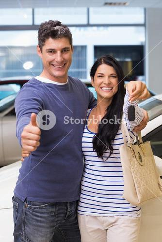 Smiling couple holding their new car key
