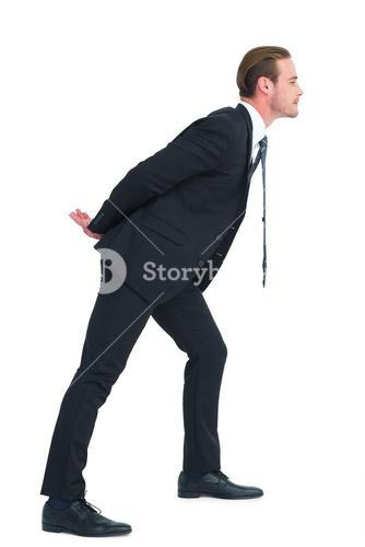Businessman in suit leaning over