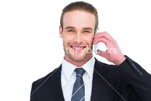 Portrait of a happy businessman phoning