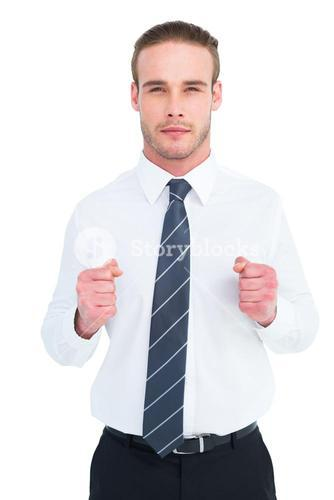 Unsmiling businessman presenting his fists