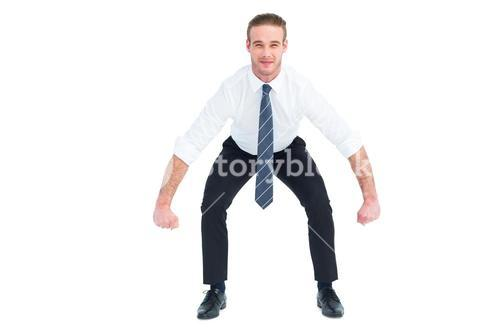 Businessman bending and lifting