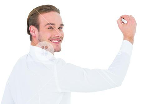 Cheerful businessman writing with marker