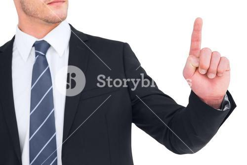 Unsmiling businessman pointing his finger