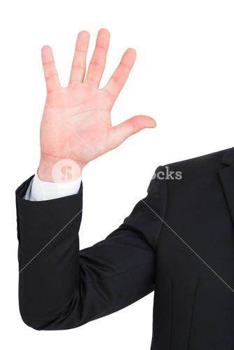 Businessman in suit with hand raised