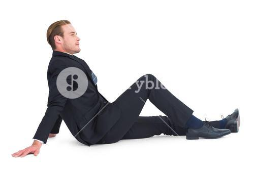 Relaxed businessman posing and thinking