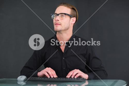 Smiling businessman typing on keyboard