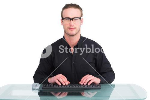Focused businessman with reading glasses working
