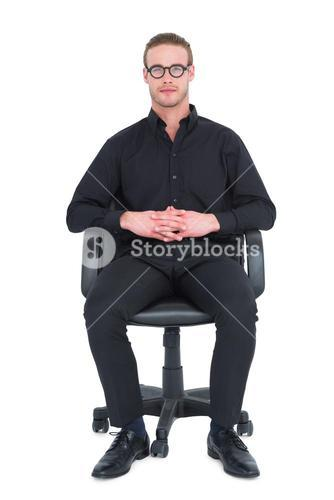 Stern businessman sitting on an office chair