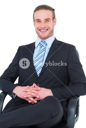 Smiling businessman sitting on an office chair