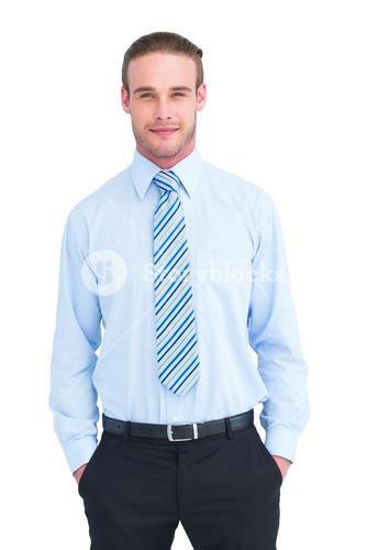 Cheerful businessman posing with hands in pockets
