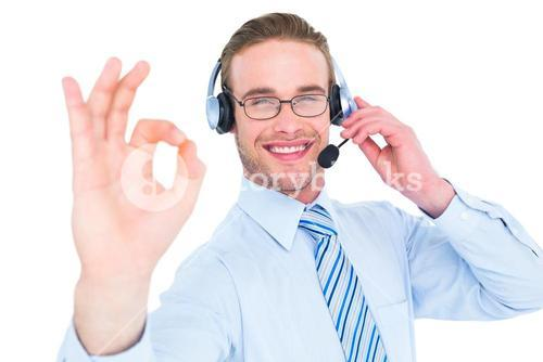 Businessman with headset making okay sign