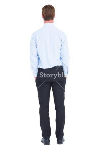 Rear view of businessman with hands in pockets