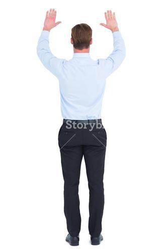Rear view of businessman with hands up