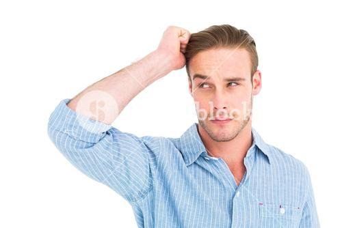 Handsome man in shirt thinking with hand on head