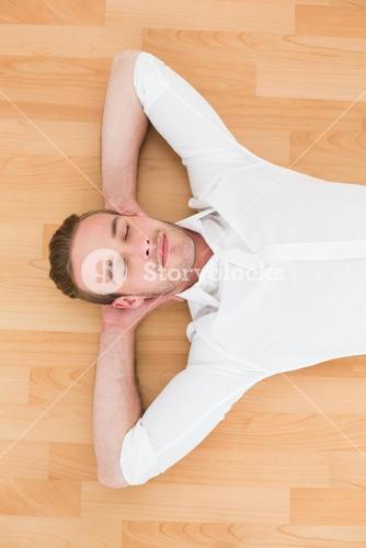 A man lying on floor at home