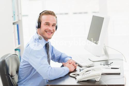 Smiling businessman speaking with headset