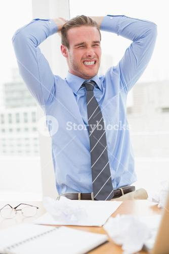 Nervous businessman with hands on head